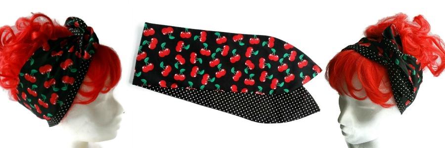 handgemaakte retro geinspireerde brede haarband met wire van rode kersjes op een zwarte ondergrond en aan de andere kant zwarte stof met witte minidots