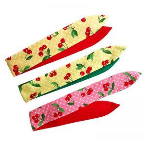 vrolijke katoenen haarbanden met aludraad in kersjes motief op een roze of gele ondergrond en met polkadots